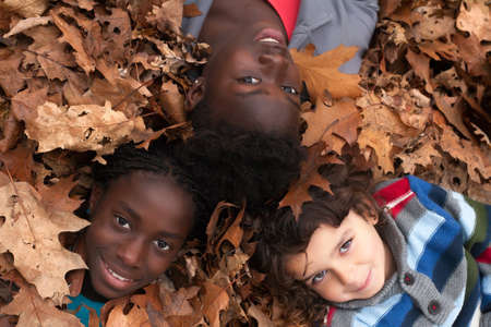 Happy family with foster children in the forest photo