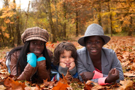 Happy family with foster children in the forest Stock Photo - 16972216
