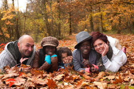 Happy family with foster children in the forest Stock Photo - 16972201