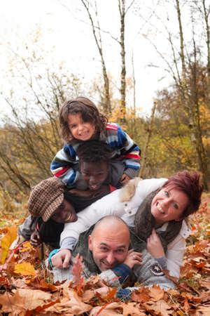 Happy family with foster children in the forest Stock Photo - 16972223