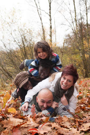 Happy family with foster children in the forest Stock Photo - 16972227