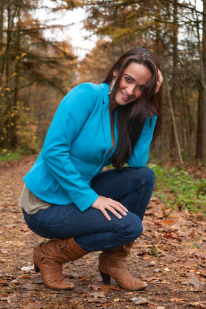 Beauty young woman in the forest is having a nice time Stock Photo - 17413987