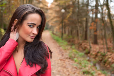 Beauty young woman in the forest is having a nice time Stock Photo - 17414218
