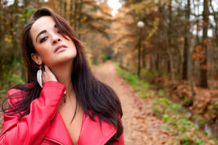 Beauty young woman in the forest is having a nice time Stock Photo - 17414213