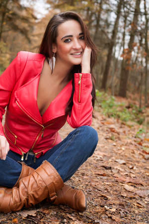 Beauty young woman in the forest is having a nice time Stock Photo - 17414211