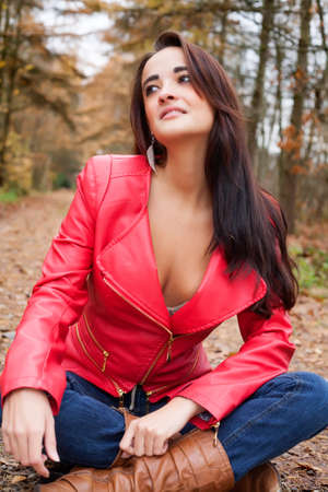 Beauty young woman in the forest is having a nice time Stock Photo - 17413984