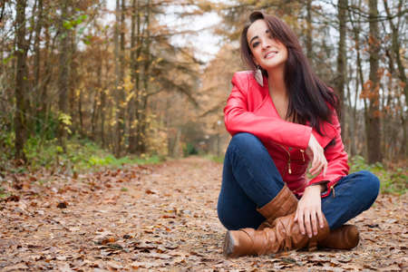 Beauty young woman in the forest is having a nice time Stock Photo - 17414215