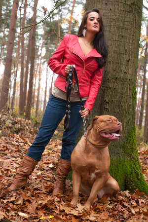 Young woman is having fun with her dog in the forest Stock Photo - 17413985