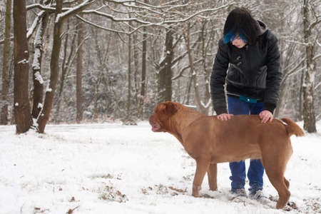 Funky boy is having fun with his dog in the snow Stock Photo - 19167326