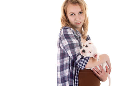 Young girl having a great time with the puppies Stock Photo - 19167315