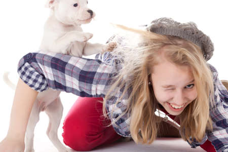 Young girl having a great time with the puppies Stock Photo - 19167319