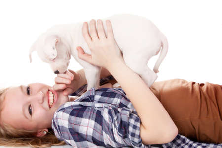 Young girl having a great time with the puppies Stock Photo - 19167321