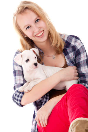 Young girl having a great time with the puppies photo