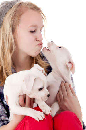 Young girl having a great time with the puppies Stock Photo - 19167327