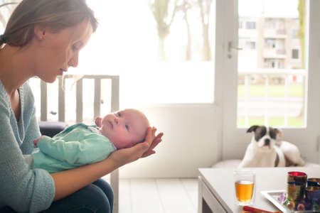 Happy young parents and their little baby Stock Photo - 19341178