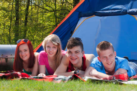 Young teenager group are having their holliday on a camping Stock Photo - 19908670