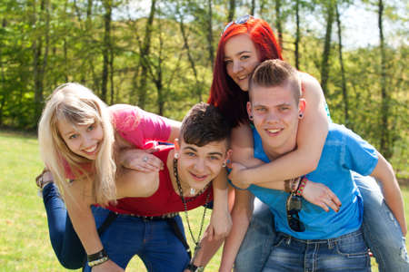 Young teenage group with colored shirts are having fun Stock Photo - 19908682