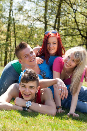 Young teenage group with colored shirts are having fun Stock Photo - 19908681