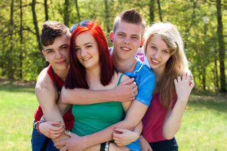 Young teenage group with colored shirts are having fun  Stock Photo - 19908675