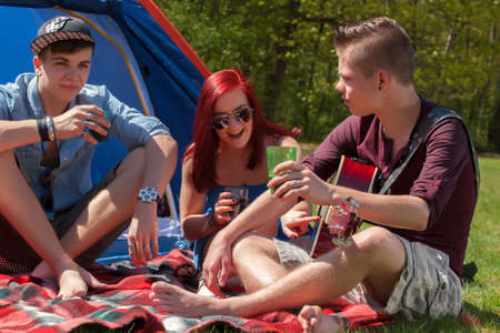 Young teenager group are having their holliday on a camping Stock Photo - 19908668