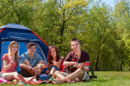 Young teenager group are having their holliday on a camping Stock Photo - 19908654
