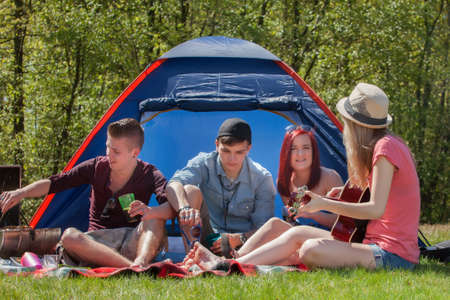 Young teenager group are having their holliday on a camping Stock Photo - 19908673