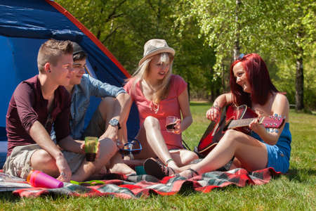 bivouac: Young teenager group are having their holliday on a camping Stock Photo