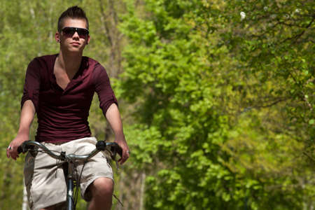 Young teenager is riding on his bicycle Stock Photo - 19908650