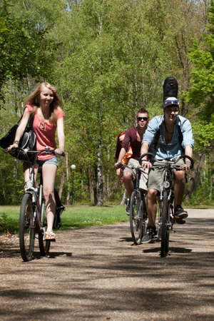 Young teenagers are making a trip with the bicycles Stock Photo - 19908676