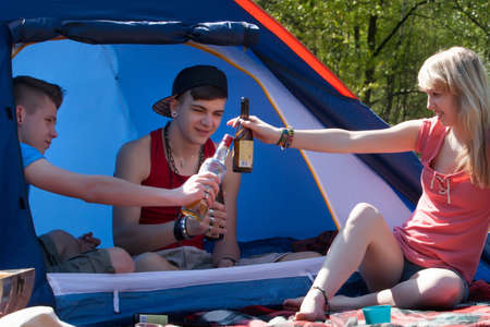 preadult: Young teenage group is having fun on a camping. Stock Photo