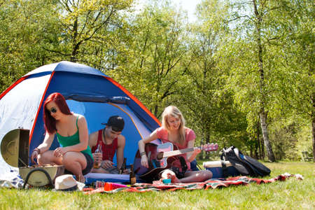 bivouac: Young teenage group is having fun on a camping