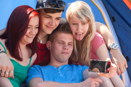 Young teeanger group are making the picture with a phone camera Stock Photo - 19908643