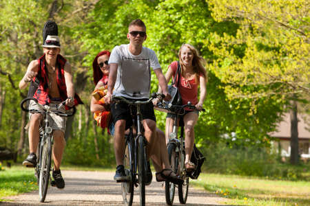 Young teenagers are making a trip with the bicycles photo
