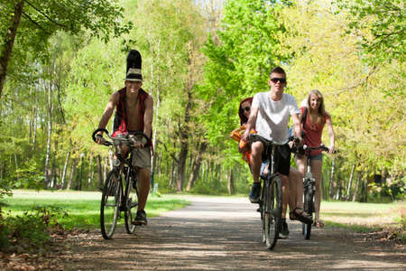 Young teenagers are making a trip with the bicycles