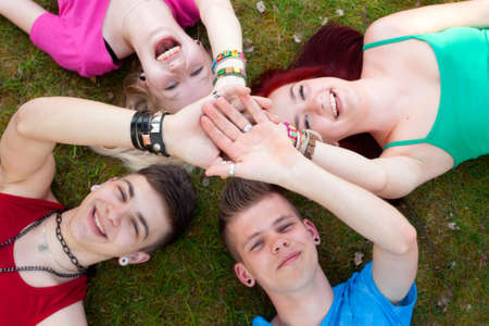 Four teenagers are having fun in the grass photo