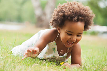 African young girl is having fun outside Stock Photo