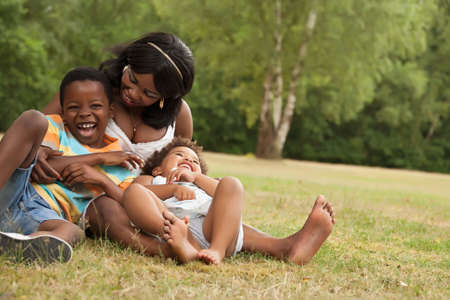African mother and her kids are having fun in the nature Banque d'images