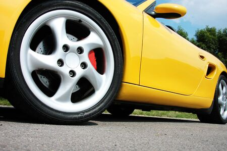 a photo of a striking yellow sports car Stock Photo - 3694235