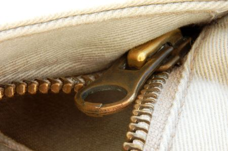 metal fastener: A macro shot of a zipper and cotton material