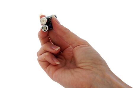 volts: An isolated image of two AAA batteries held between fingers
