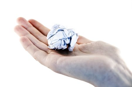 screwed: An isolated to white image of a screwed up white paper ball on a palm