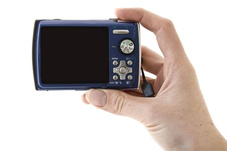 capture the moment: An isolated to white photo of a digital camera ready to take a photo Stock Photo