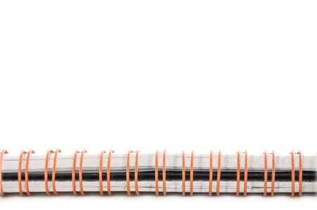 An isolated to white image of a notebook spiral spine photo
