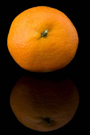 An isolated image of a fresh orange on a black background Stok Fotoğraf