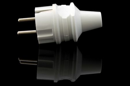 An isolated image of a European power plug on a black background Stock Photo - 4030659