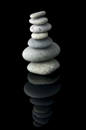 An isolated to black image of 7 stones stacked photo