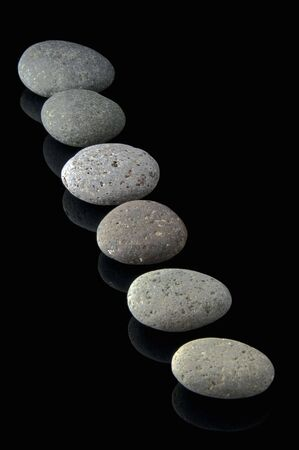 stepping: An isolated to black image of 6 stones