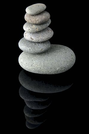 An isolated to black image of 6 stones stacked