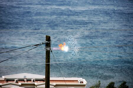 sparking: A photo of electricity wires crossing and sparking