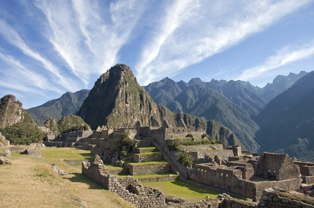 peru architecture: Amazing cloud formations over Macchu Picchu